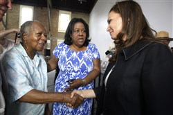 U.S.Treasurer Rosa Rios, right, smiles as she's introduced to Harriet Tubman's great-great-grand niece, Pauline Copes-Johnson of Auburn, N.Y., left, before a town hall meeting in Seneca Falls, N.Y.