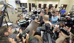 Surrounded by the media, David Moore, center, and his partner David Ermold attempt to apply for a marriage license at the Rowan County Courthouse in Morehead, Ky., on Tuesday.