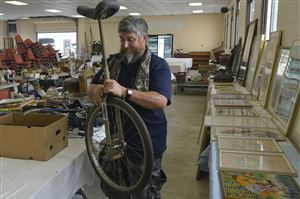 Mike Riley brings in household goods and art as he prepares for an, auction at the Washington County Fairgrounds.