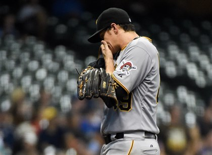 Pirates pitcher Jeff Locke reacts after giving up two runs in the fourth inning against the Milwaukee Brewers.