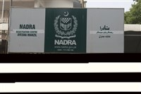 A man looks into the office of Pakistan's National Data and Registration Authority (NADRA) on Tuesday which was closed by authorities in Karachi, Pakistan.