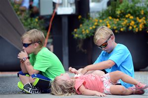 From left, siblings Daniel, 7, Carolyn, 2, and Ben Davies, 9, of Mt. Lebanon listen to the Pittsburgh Symphony Orchestra Brass Quintet during the Market Square Farmers Market, Downtown.
