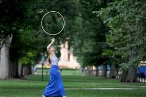Kaitlyn Stocker, 21, a senior from Bucks County, hoop dances on the Mall at Penn State University in State College.