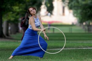 Senior Kaitlyn Stocker, 21, of Bucks County hoop dances on the Mall at Penn State University in State College.