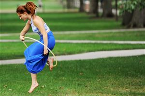 Senior Kaitlyn Stocker, 21, jumps through her hoop on the Mall at Penn State University in State College.