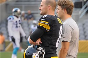 Steelers kicker Josh Scobee, left, talks with injured kicker Shaun Suisham before the Carolina game at Heinz Field on Thursday night.