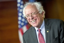 Sen. Bernie Sanders smiles while responding to a question during a news conference on Capitol Hill in April.