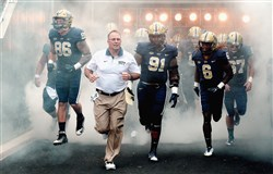 Pitt coach Pat Narduzzi leads seniors J.P. Holtz, Daryl Render and Lafayette Pitts onto the field earlier this season.