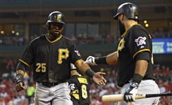 Pirates right fielder Gregory Polanco celebrates with first baseman Pedro Alvarez after scoring a run against the St. Louis Cardinals during the first inning at Busch Stadium.