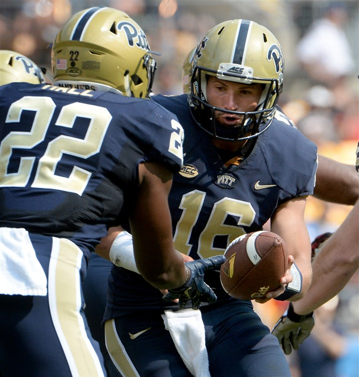 20150905mfpittsports20-11 Pitt quarterback Chad Voytik hands off to Darrin Hall against Youngstown State.