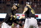 The Pirates' Starling Marte, left, is congratulated by third base coach Rick Sofield after hitting a two-run home run during the ninth inning Sunday against the Cardinals.