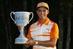 Rickie Fowler holds the trophy after winning the Deutsche Bank Championship golf tournament Monday in Norton, Mass.