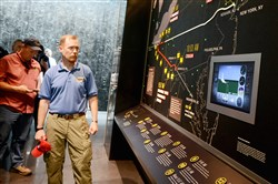 Gordon Felt, whose brother Edward Felt died aboard Flight 93, views a display Wednesday that shows the path of the United Airlines flight on Sept. 11 at the Flight 93 National Memorial visitors center in Somerset County.