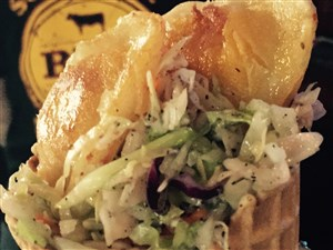 The Almost Famous Rogicone is a waffle cone filled pepper jack mac 'n' cheese, coleslaw and topped with pierogies.