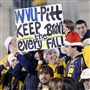 A fan shows her support for continuing the Backyard Brawl during the 2011 game, the last one played between Pitt and WVU.