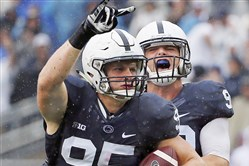 Penn State defensive end Carl Nassib (95) celebrates his second half interception with defensive end Garrett Sickels (90) during an NCAA college football game against Buffalo in State College, Pa., Sept. 12, 2015.