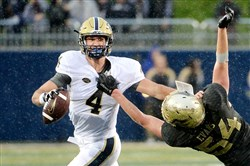 Pitt quarterback Nate Peterman tries to fend off Akron's Dylan Evans in the second quarter Sept. 12.