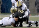 Pitt's Tyrique Jarrett and Rori Blair take down Akron's Conor Hundley earlier in the season.