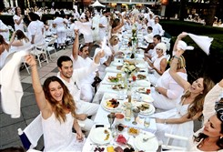 Waving the napkin at the beginning of Diner en Blanc in Gateway Plaza are Carolyn Coss, left foreground and, clockwise, Adam and Sara DePuglia and Laura Mullin.