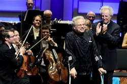 Violinist Itzhak Perlman at the end of his performance, with Manfred Honeck, PSO Music Director at right, during the Cinema Serenade of the Pittsburgh Symphony Orchestra performing at Heinz Hall.