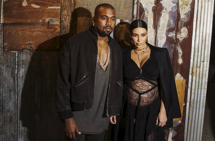 USA-FASHION/-1 Kanye West and Kim Kardashian were among the celebrity guests at Givenchy's New York Fashion Week debut in September. But the audience also included several hundred members of the public who received tickets in an online giveaway.