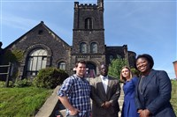 Standing outside the 110-year-old Albright Methodist Church in September are, from left, Ryan Morden, Abass B. Kamara, Lindsay Patross and Taafori Kamara. Mr. Morden and Ms. Patross are with Friends of Albright. The Kamaras are brother and sister and are members of the congregation.