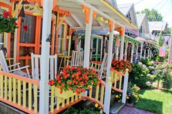 Gingerbread cottages in Oak Bluffs, Martha's Vineyard, are among the top attractions on the island. They were built by Methodists who had first a camp, then a small enclave on the island to hold revival meetings. Now they are all privately owned.
