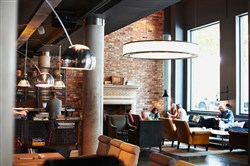 This is the lobby of the Hoxton, Shoreditch hotel in London.