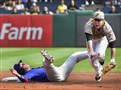 The Cubs' Chris Coghlan collides with Pirates shortstop Jung Ho Kang at PNC Park Thursday afternoon.