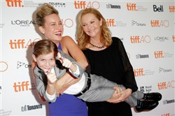 "Brie Larson, left, and Joan Allen give Jacob Tremblay a lift to the premiere of ""Room"" during the 2015 Toronto International Film Festival."