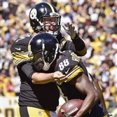 Steelers quarterback Ben Roethlisberger greets Darrius Heyward-Bey after the received pulled in a touchdown pass from the quarterback in the first half.