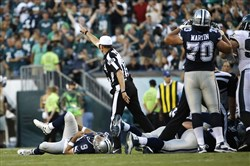 Dallas Cowboys' Tony Romo lies on the ground after an injury during the second half of an NFL football game against the Philadelphia Eagles, Sunday, Sept. 20, 2015, in Philadelphia.