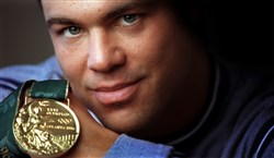 Kurt Angle with the gold medal he won in the 1996 Atlanta Olympics.