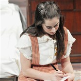 "Pittsburgh Public Theater production of ""The Diary of Anne Frank"" directed by Pamela Berlin opens September 24 and runs through October 15, 2015 at the O'Reilly Theater.  Here  Anne, played by Remy Zaken writes in her diary."