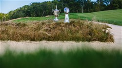 The U.S. Open trophy sits along side the Lombardi Trophy on one of Oakmont Country Club's famed holes.