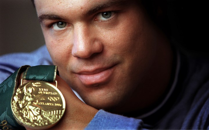 kurt3.jpg Kurt Angle with the gold medal he won in the 1996 Atlanta Olympics.