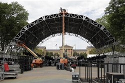 Workmen construct a stage Tuesday ahead of the pope's visit to Philadelphia on Saturday.
