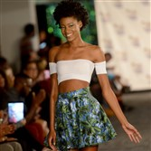 A model wearing a Mayfield Avenue design walks the runway at the kick-off event for Pittsburgh Fashion Week held at Highmark Stadium in Station Square on Monday, Sept. 21, 2015.