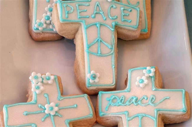 Peaceful Pope Cookies are vanilla shortbread cookies with a fondant icing, and are made by the Night Kitchen Bakery in Philadelphia.