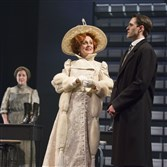 "Fiona Reid as Sarah Bernhardt and Ben Sanders as Michaud, with Jenny L. Wright as These Destroyers (background), in ""The Divine: A Play for Sarah Bernhardt."""