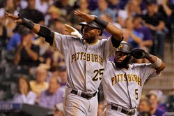 Gregory Polanco and Josh Harrison celebrate after scoring on a double by Starling Marte against the Colorado Rockies last week at Coors Field in Denver, Colorado.