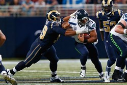 Penn Hills native Aaron Donald of the St. Louis Rams sacks Russell Wilson of the Seattle Seahawks in overtime to help seal a 34-31 St. Louis victory on Sept. 13.