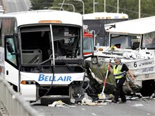 Four students were killed and dozens injured when a duck-boat tour vehicle collided with a charter bus Thursday in Seattle.
