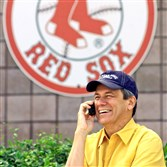 Larry Lucchino talks on his cell phone on his first visit to the Red Sox spring training facility back in 2002 in Fort Myers, Fla., before becoming the team's president.