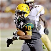 Seton-LaSalle's Lionel Deanes carries for a touchdown last season against Steel Valley.