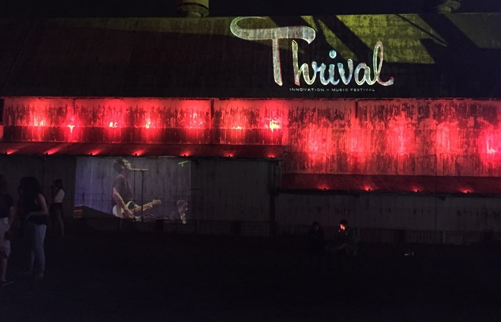 thrival.JPG Panic! at the Disco projected off of the LTV warehouse building in Hazelwood at Thrival Friday night.