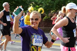 Janice States of Presto, Pa., waves to the crowd during  the Richard S. Caliguiri City of Pittsburgh Great Race.