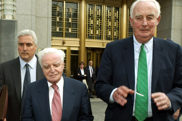Companies Behaving Badly -3 Adelphia Communications Corp. founder John Rigas, center, leaves federal court in New York in 2004 after he and his son Timothy were convicted of fraud. Rigas is expected to be released from prison for health reasons.