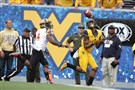 West Virginia wide receiver Shelton Gibson catches a touchdown pass while being defended by Maryland defensive back William Likely during the first half Saturday, Sept. 26, 2015, in Morgantown, W.Va.