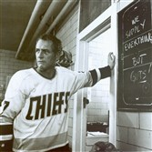 "Paul Newman as Reggie Dunlop, player-coach of a third-rate hockey team, in 1977's ""Slap Shot."" The film elevated Johnstown into the popular culture, and Newman made minor league hockey cool."